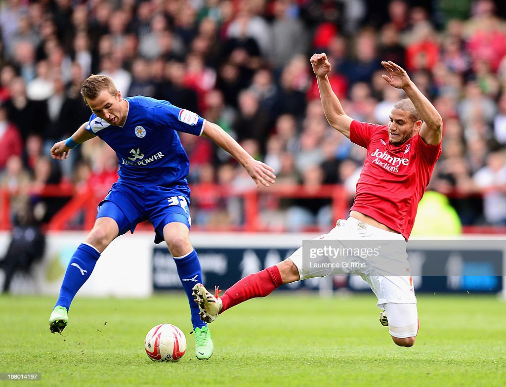 Harry Kane of Leicester City battles with Adlene Guedioura of Nottingham Forest during the npower Championship match between Nottingham Forest and Leicester City at City Ground on May 4, 2013 in Nottingham, England.