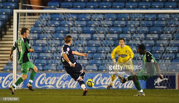 Harry Kane of Millwall scores his team's second goal during the FA Cup Third Round Replay between Millwall and Dagenham Redbridge at The Den on...