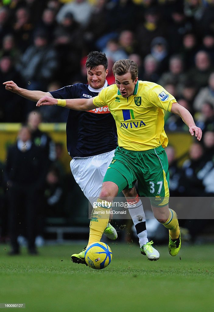 Harry Kane of Norwich City battles with Janos Kovacs of Luton Town during the FA Cup with Budweiser fourth round match between Norwich City and Luton Town at Carrow Road on January 26, 2013 in Norwich, England.
