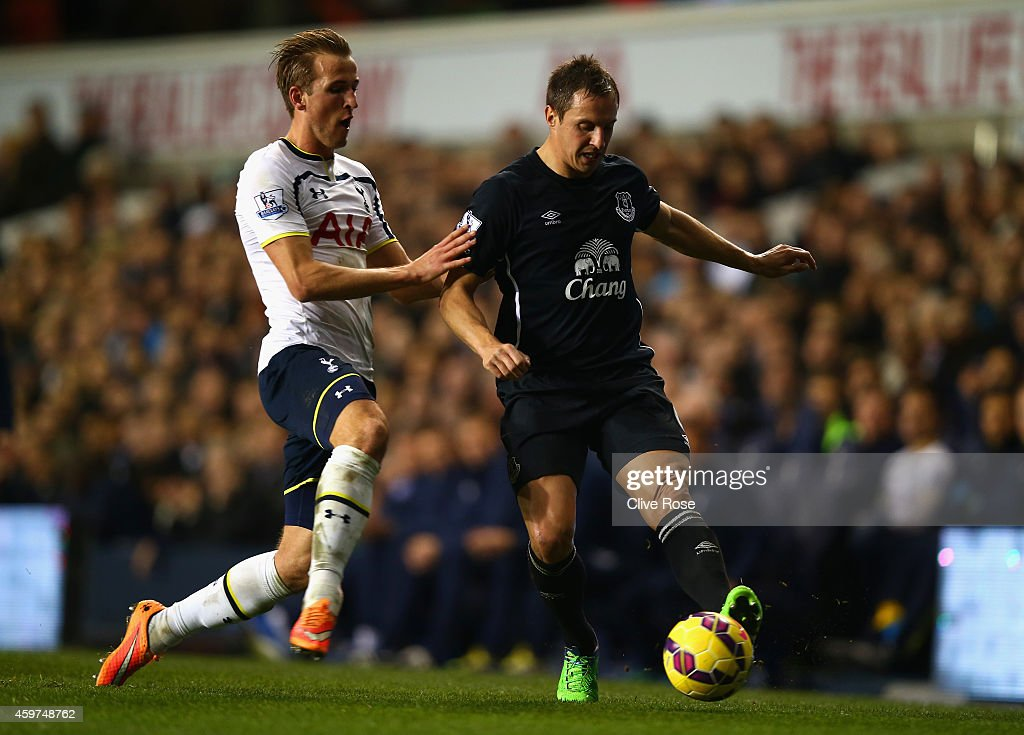 Harry Kane of Spurs and Phil Jagielka of Everton battle for the ball during the Barclays Premier League match between Tottenham Hotspur and Everton at White Hart Lane on November 30, 2014 in London, England.