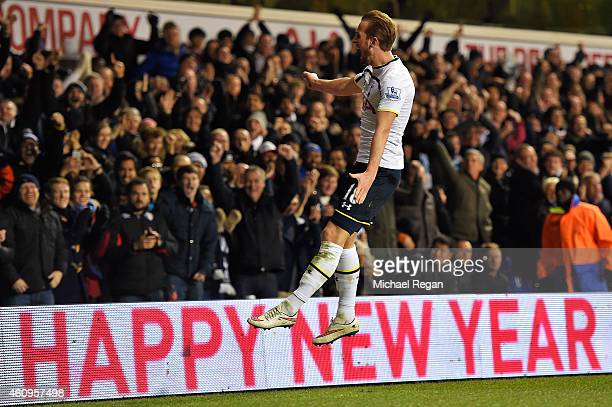 Harry Kane of Spurs celebrates after scoring his team's first goal during the Barclays Premier League match between Tottenham Hotspur and Chelsea at...
