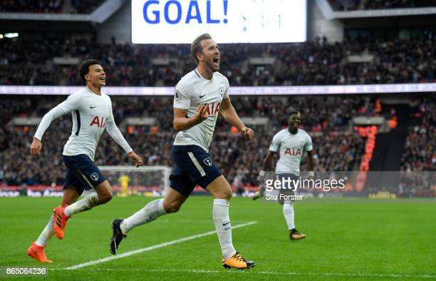 Harry Kane of Spurs celebrates with Dele Ali after scoring the fourth goal and his second of the game during the Premier League match between...