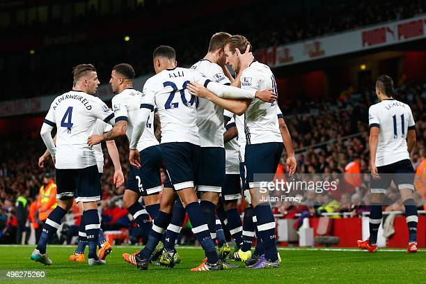 Harry Kane of Spurs celebrates with his team mates after scoring his side's opening goal during the Barclays Premier League match between Arsenal and...