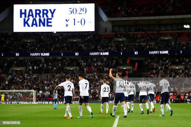Harry Kane of Spurs celebrates with team mates after scoring a goal during the Premier League match between Tottenham Hotspur and Newcastle United at...