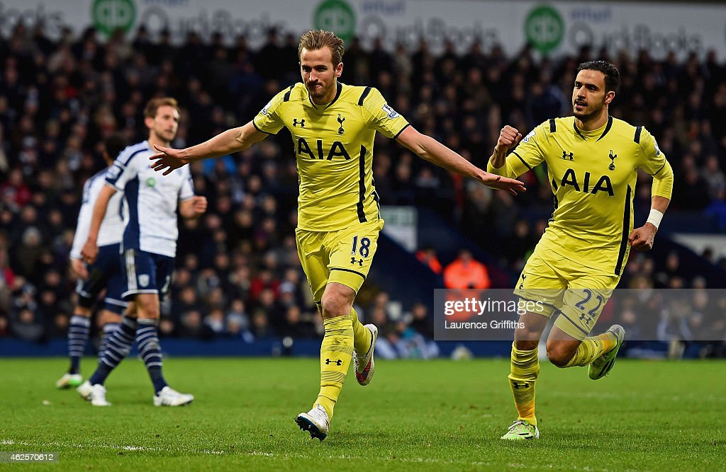Harry Kane (L) of Spurs celebrates with teammate Nacer Chadli (R) of Spurs after scoring his team's third goal from the penalty spot during the Barclays Premier League match between West Bromwich Albion and Tottenham Hotspur at The Hawthorns on January 31, 2015 in West Bromwich, England.