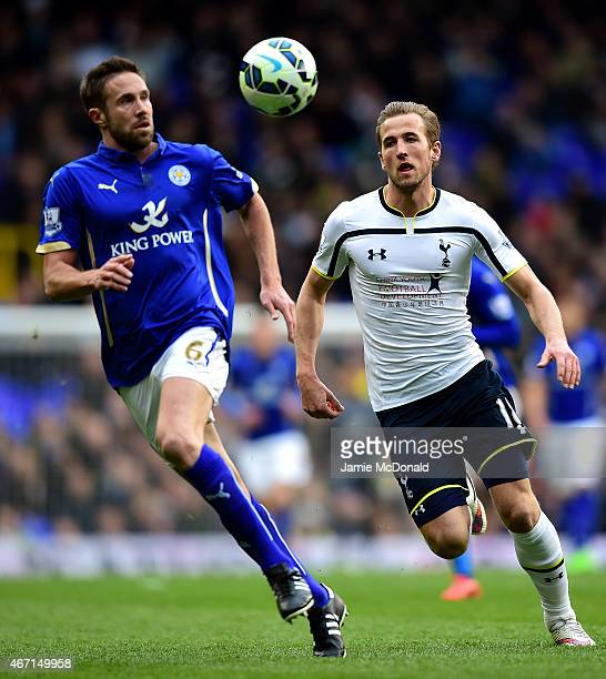 Harry Kane of Spurs chases Matthew Upson of Leicester City during the Barclays Premier League match between Tottenham Hotspur and Leicester City at...