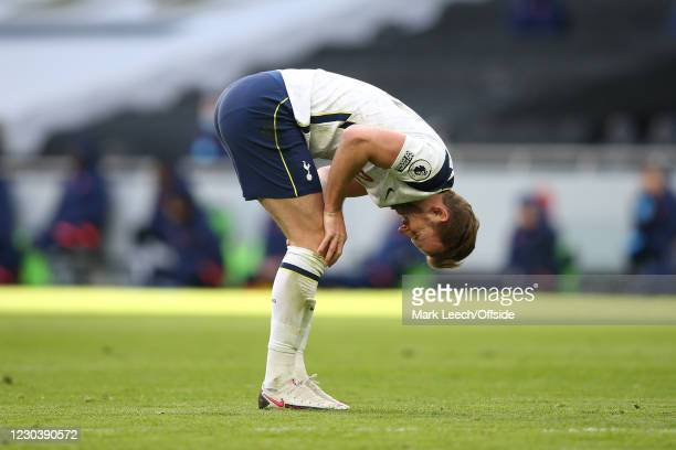 Harry Kane of Spurs folds over and winces during the Premier League match between Tottenham Hotspur and Leeds United at Tottenham Hotspur Stadium on...