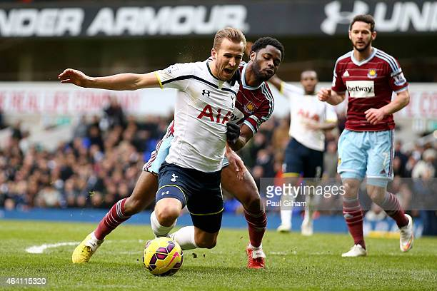 Harry Kane of Spurs goes down under the challenge from Alexandre Song of West Ham to win an injury time penalty during the Barclays Premier League...