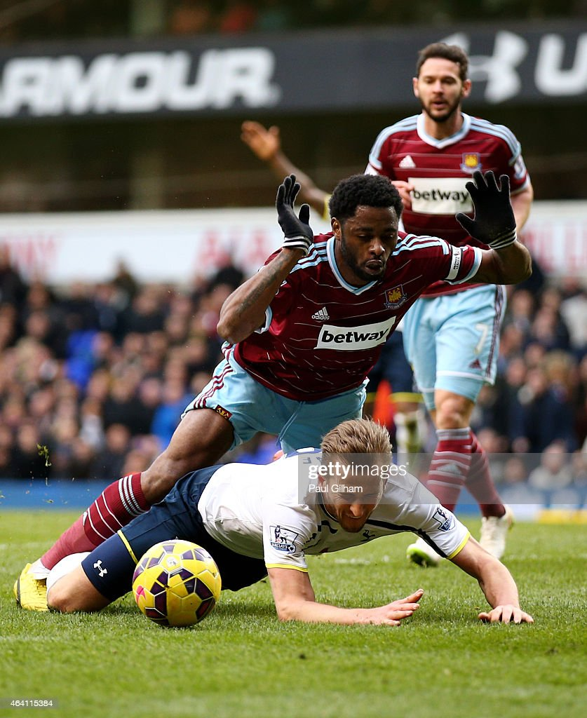Harry Kane of Spurs goes down under the challenge from Alexandre Song of West Ham to win an injury time penalty during the Barclays Premier League match between Tottenham Hotspur and West Ham United at White Hart Lane on February 22, 2015 in London, England.