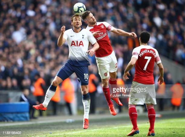 Harry Kane of Spurs goes for a header with Shkodran Mustafi of Arsenal during the Premier League match between Tottenham Hotspur and Arsenal FC at...
