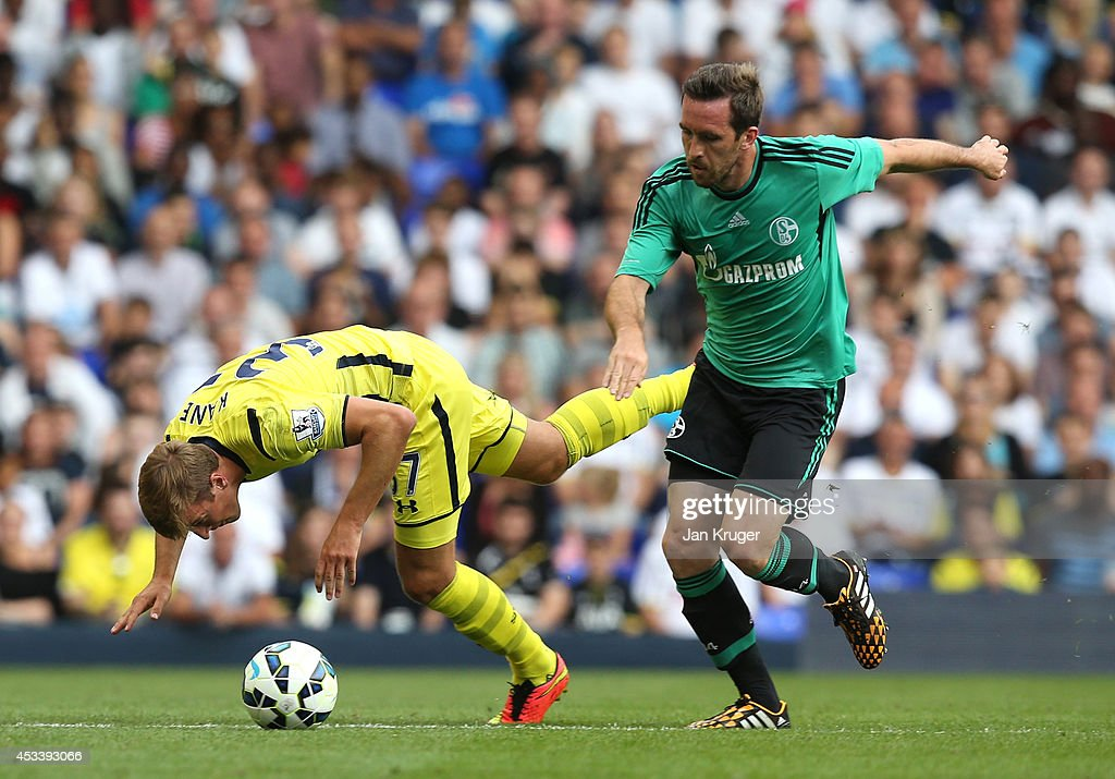 Harry Kane (L) of Spurs goes over under pressure from Christian Fuchs of Schalke during a pre season friendly match between Tottenham Hotspur and FC Schalke at White Hart Lane on August 9, 2014 in London, England.