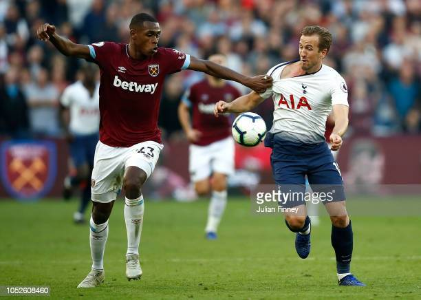Harry Kane of Spurs has his shirt pulled by Issa Diop of West Ham during the Premier League match between West Ham United and Tottenham Hotspur at...