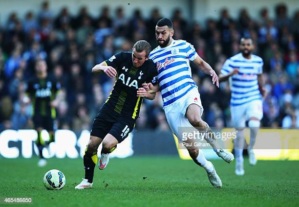 Harry Kane of Spurs holds off Steven Caulker of QPR during the Barclays Premier League match between Queens Park Rangers and Tottenham Hotspur at...