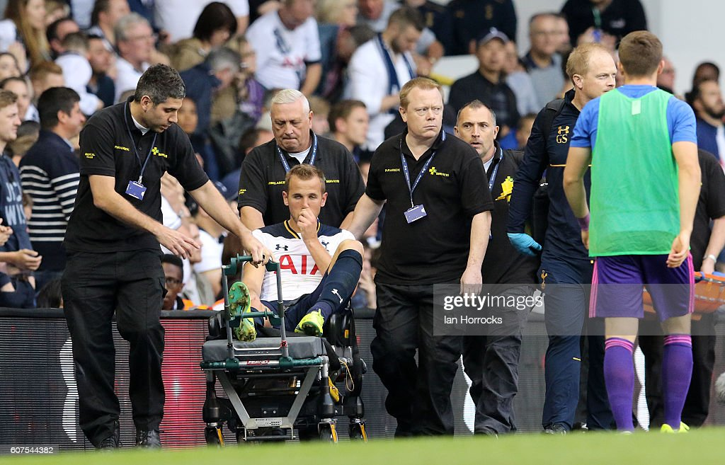 Harry Kane of Spurs is carried off injured during the Premier League match between Tottenham Hotspur and Sunderland at White Hart Lane on September 18, 2016 in London, England.