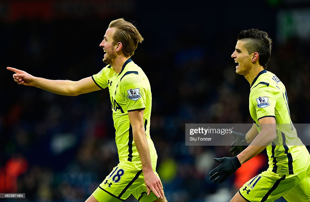 Harry Kane of Spurs is congratulated by teammate Erik Lamela of Spurs after scoring is team'ssecond goal during the Barclays Premier League match between West Bromwich Albion and Tottenham Hotspur at The Hawthorns on January 31, 2015 in West Bromwich, England.
