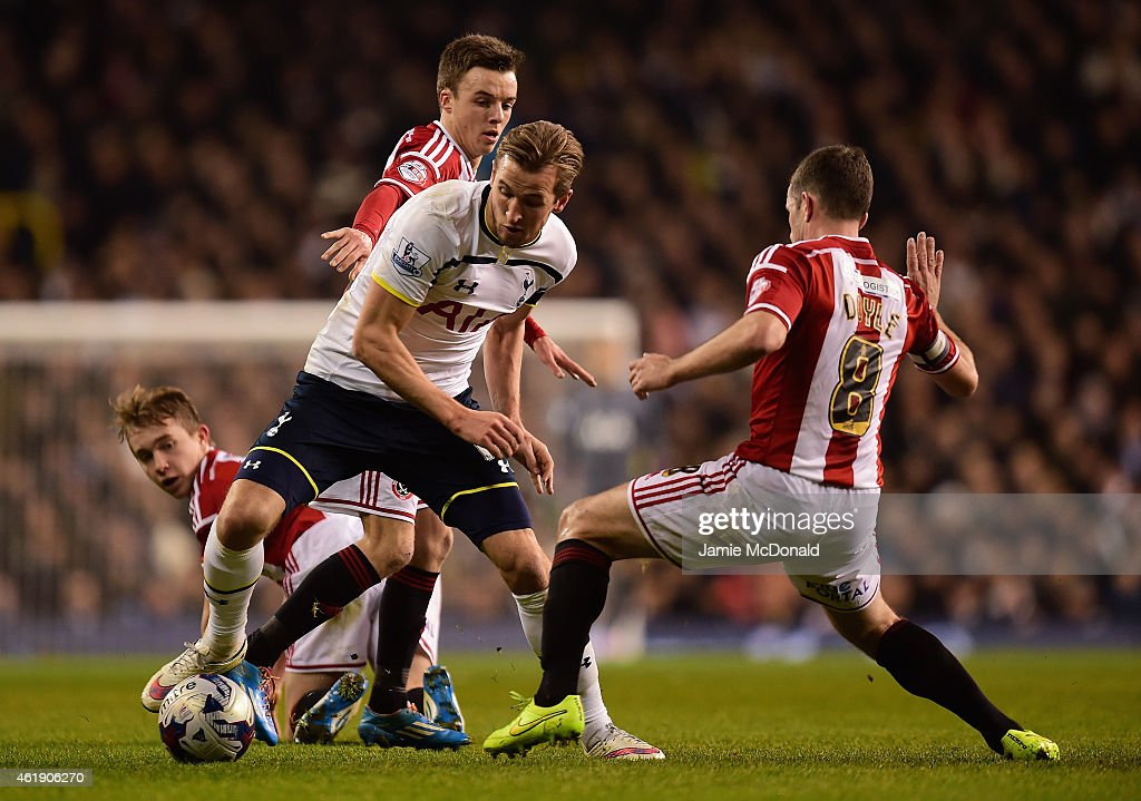 Harry Kane of Spurs is tackled by Michael Doyle of Sheffield United during the Capital One Cup Semi-Final first leg match between Tottenham Hotspur and Sheffield United at White Hart Lane on January 21, 2015 in London, England.