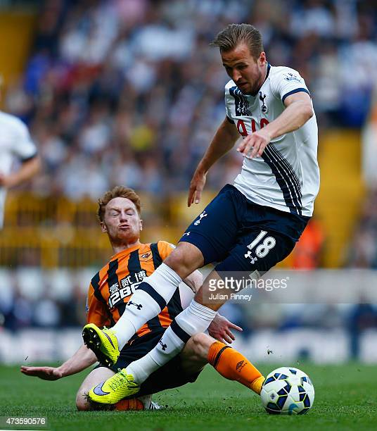 Harry Kane of Spurs is tackled by Stephen Quinn of Hull City during the Barclays Premier League match between Tottenham Hotspur and Hull City at...