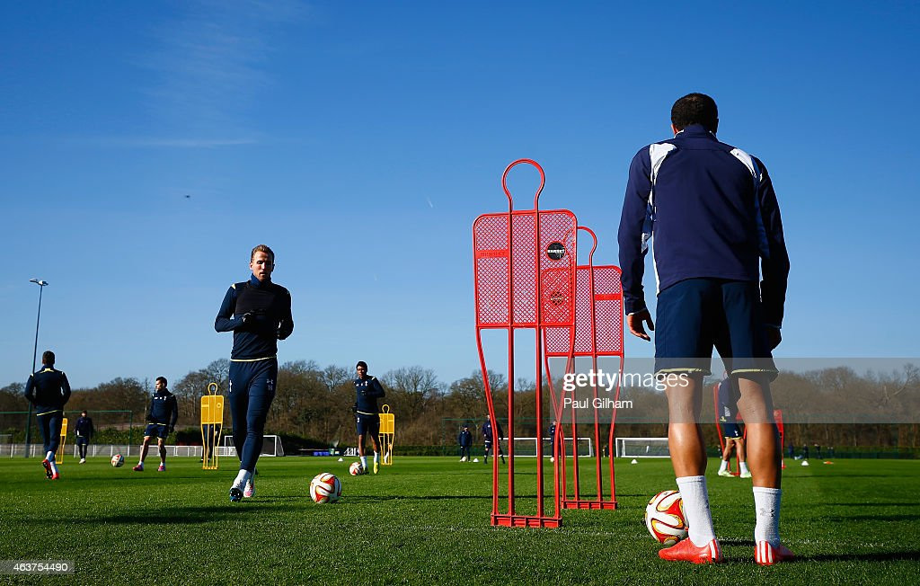 Harry Kane of Spurs (L) on the ball during a training session ahead of the UEFA Europa League round of 32 first leg match against Fiorentina at Enfield Training Centre on February 18, 2015 in Enfield, United Kingdom.