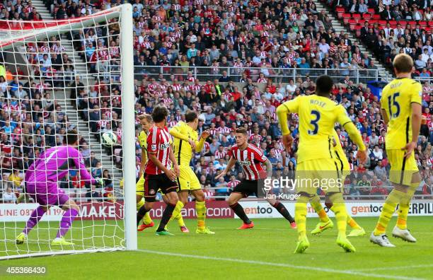 Harry Kane of Spurs scores an own goal during the Barclays Premier League match between Sunderland and Tottenham Hotspur at Stadium of Light on...