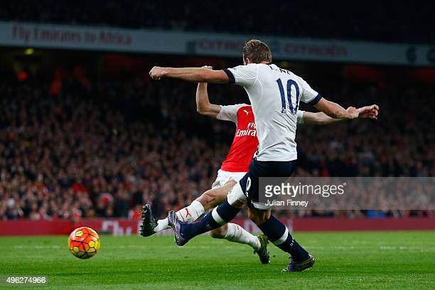 Harry Kane of Spurs scores his side's opening goal during the Barclays Premier League match between Arsenal and Tottenham Hotspur at the Emirates...