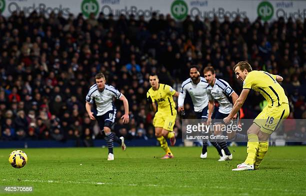 Harry Kane of Spurs scores his team's third goal from the penalty spot during the Barclays Premier League match between West Bromwich Albion and...