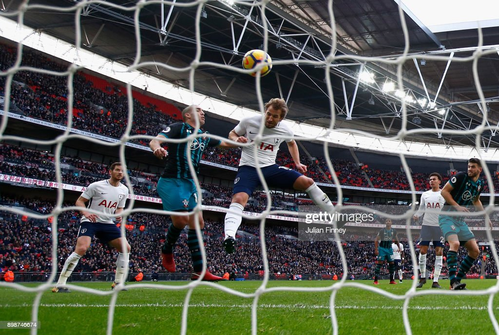 Harry Kane of Spurs scores the opening goal with a header to go past Alan Shearer's calendar year scoring record during the Premier League match between Tottenham Hotspur and Southampton at Wembley Stadium on December 26, 2017 in London, England.