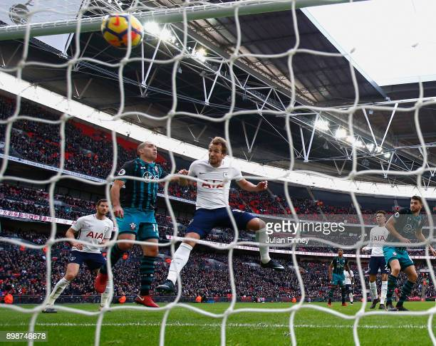Harry Kane of Spurs scores the opening goal with a header to go past Alan Shearer's calendar year scoring record during the Premier League match...