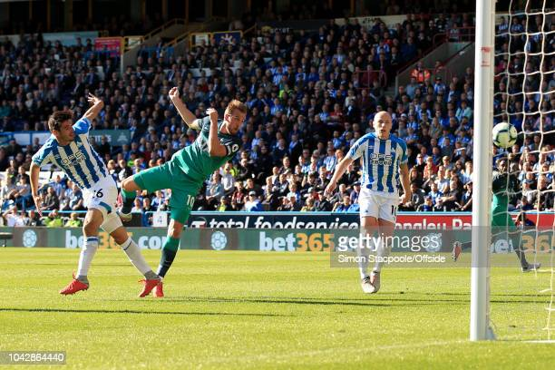 Harry Kane of Spurs scores their 1st goal during the Premier League match between Huddersfield Town and Tottenham Hotspur at the John Smith's Stadium...
