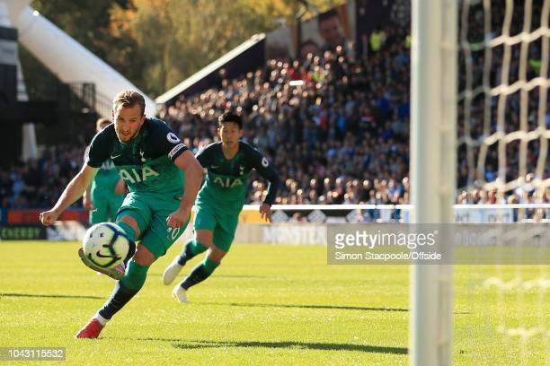 Harry Kane of Spurs scores their 2nd goal with a penalty during the Premier League match between Huddersfield Town and Tottenham Hotspur at the John...