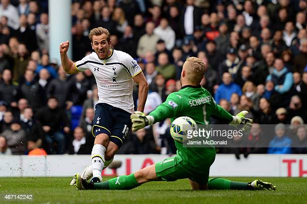 Harry Kane of Spurs shoots at goal past Kasper Schmeichel of Leicester City during the Barclays Premier League match between Tottenham Hotspur and...