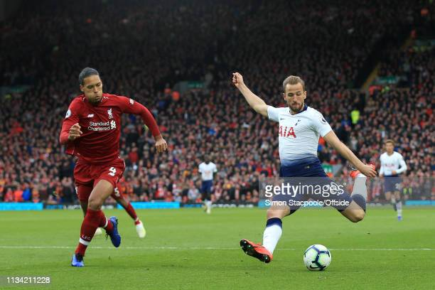 Harry Kane of Spurs shoots past Virgil van Dijk of Liverpool during the Premier League match between Liverpool and Tottenham Hotspur at Anfield on...