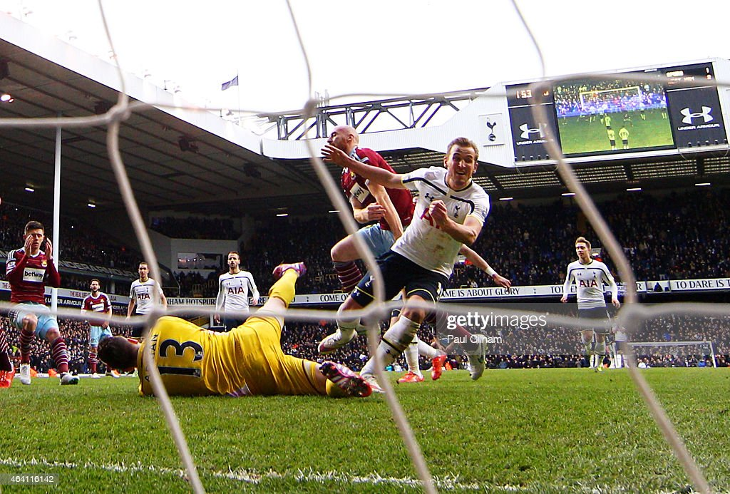 Harry Kane of Spurs turns away to celebrate, after scoring past goalkeeper Adrian of West Ham from the penalty rebound to level the scores at 2-2 during the Barclays Premier League match between Tottenham Hotspur and West Ham United at White Hart Lane on February 22, 2015 in London, England.