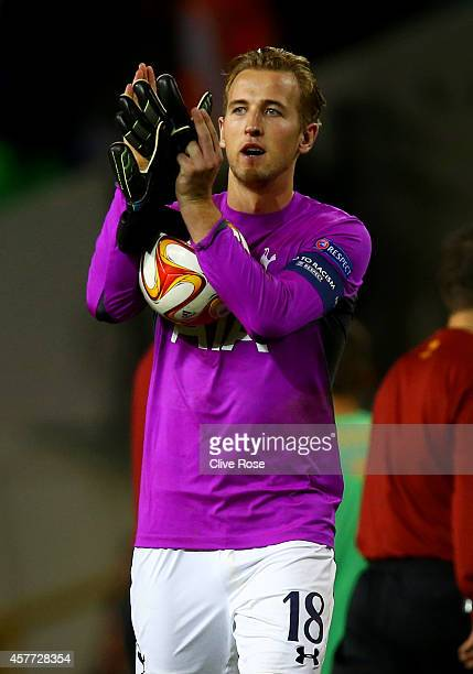 Harry Kane of Spurs wearing the goalkeeper's shirt of teammate Hugo Lloris applauds the fans as holds the match ball following his hattrick during...
