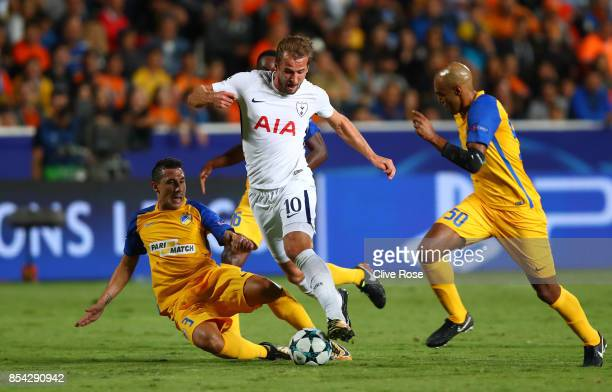 Harry Kane of Totenham Hotspur attempts to get past Carlao of Apoel FC during the UEFA Champions League Group H match between Apoel Nicosia and...