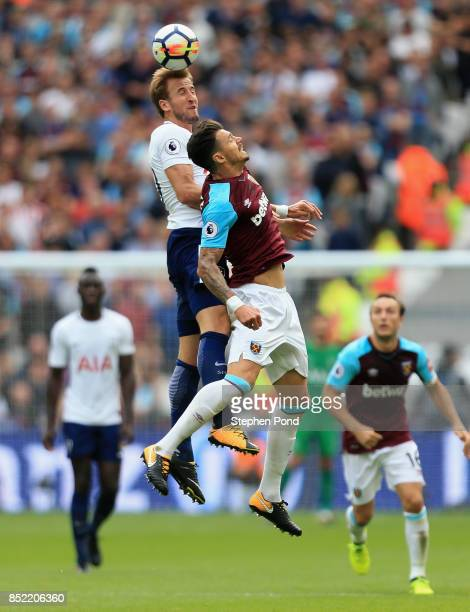 Harry Kane of Tottenha Hotspur wins a header over Jose Fonte of West Ham United during the Premier League match between West Ham United and Tottenham...