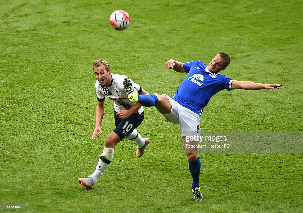 Harry Kane of Tottenham and Phil Jagielka of Everton in action during the Barclays Premier League match between Tottenham Hotspur and Everton at White Hart Lane on August 29, 2015 in London, United Kingdom.