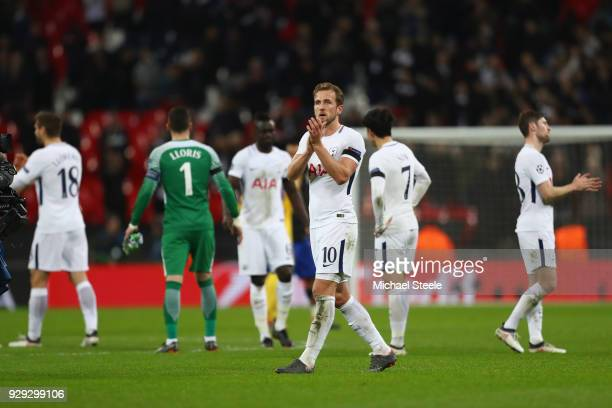 Harry Kane of Tottenham applauds the supporters following his teams 12 defeat during the UEFA Champions League Round of 16 Second Leg match between...