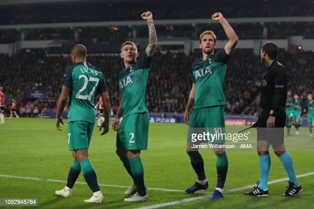 Harry Kane of Tottenham celebrates after scoring a goal to make it 2-1 during the Group B match of the UEFA Champions League between PSV and...