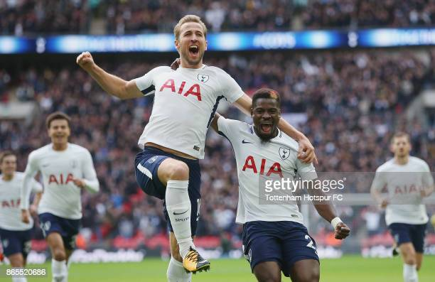 Harry Kane of Tottenham celebrates scoring the first goal for Tottenham with Serge Aurier during the Premier League match between Tottenham Hotspur...