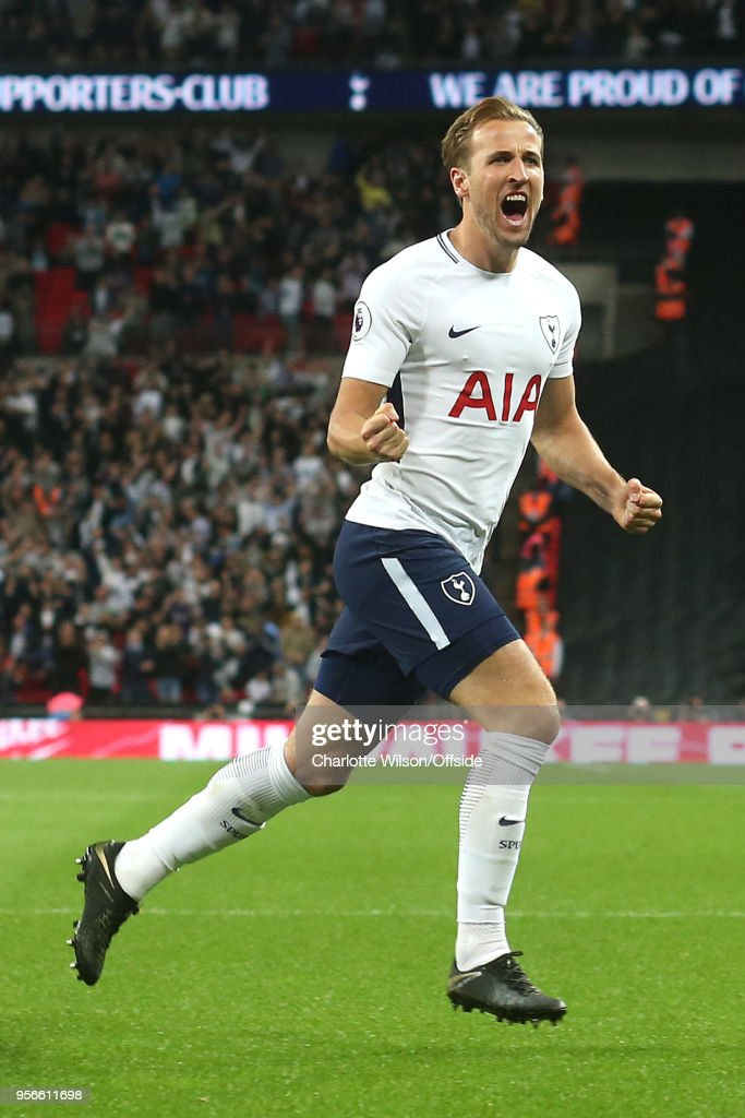 Harry Kane of Tottenham celebrates scoring the opening goal during the Premier League match between Tottenham Hotspur and Newcastle United at Wembley Stadium on May 9, 2018 in London, England.