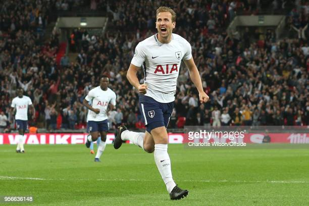 Harry Kane of Tottenham celebrates scoring the opening goal during the Premier League match between Tottenham Hotspur and Newcastle United at Wembley...