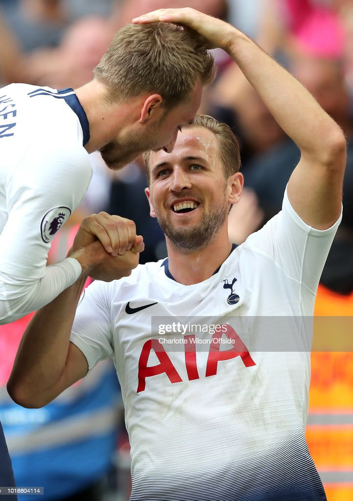 Harry Kane of Tottenham celebrates scoring their 3rd goal with Christian Eriksen of Tottenham during the Premier League match between Tottenham Hotspur and Fulham FC at Wembley Stadium on August 18, 2018 in London, United Kingdom.