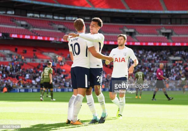Harry Kane of Tottenham celebrates scoring to make it 10 with Dele Alli during the preseason match between Tottenham Hotspur and Juventus at Wembley...