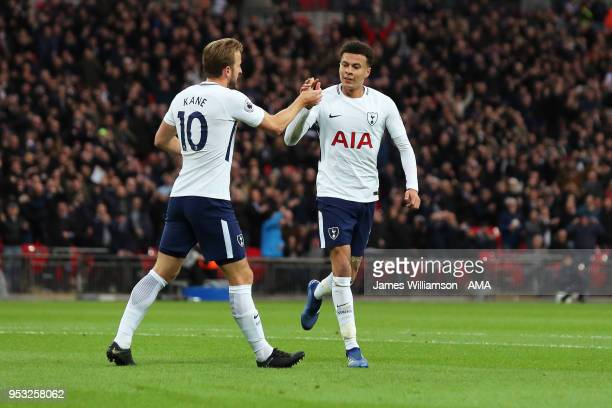 Harry Kane of Tottenham celebrates with Dele Alli of Tottenham after Alli scored a goal to make it 10 during the Premier League match between...