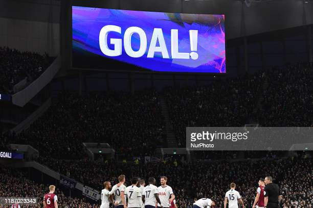 Harry Kane of Tottenham celebrates with his team mates after scoring during the Premier League match between Tottenham Hotspur and Burnley at White...