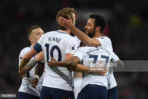 Harry Kane of Tottenham celebrates with team mates after scoring his second goal during The Emirates FA Cup Third Round match between Tottenham...