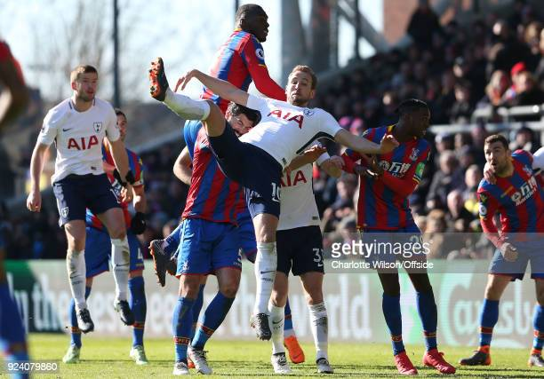 Harry Kane of Tottenham falls across James Tomkins of Crystal Palace Ben Davies of Tottenham and Aaron WanBissaka after going up for a header with...