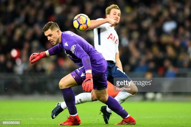 Harry Kane of Tottenham gets a head past Stoke Citys Jack Butland during Premier League match between Tottenham Hotspur against Stoke City at Wembley...