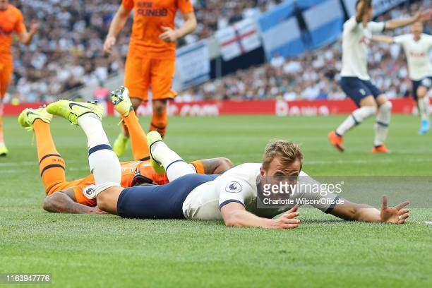 Harry Kane of Tottenham holds out his arms in disbelief after a penalty isn't given for a tackle against him during the Premier League match between...