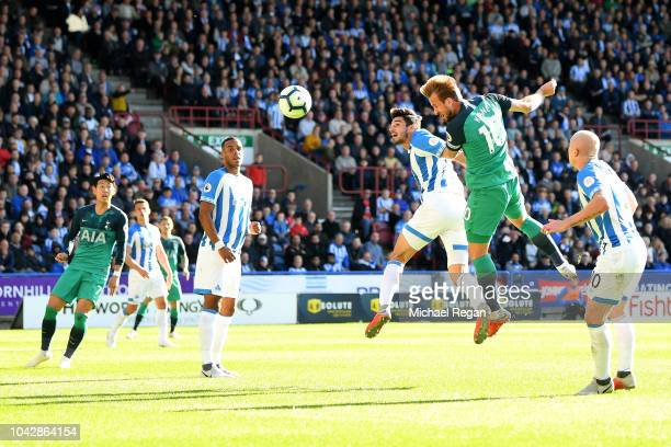Harry Kane of Tottenham Hostspur heads into score the opening goal during the Premier League match between Huddersfield Town and Tottenham Hotspur at...